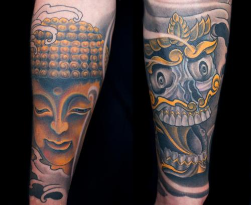 Detail of Buddha and Tibetan skull tattoo