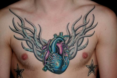 Sacred heart chest tattoo