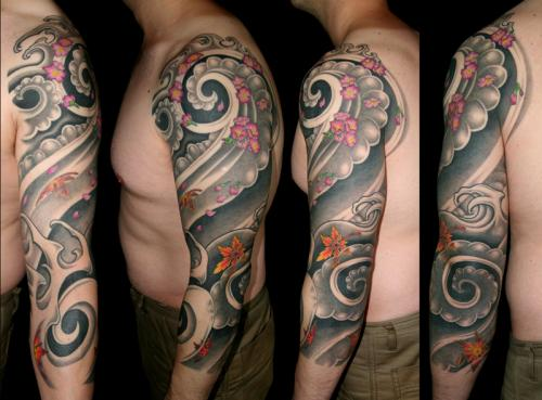 Three quarter oriental wind, maple and cherry blossom tattoo