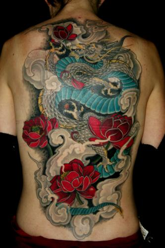 Feminine dragon full back tattoo